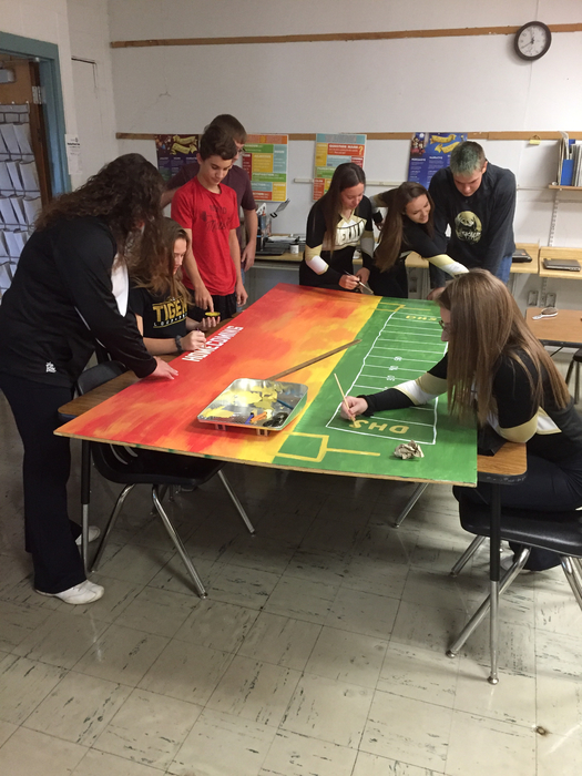 Sophomores working on their homecoming board.