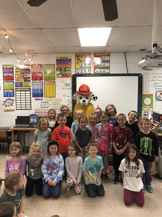 The first graders and Sparky the fire dog.