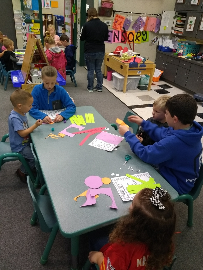 6th graders helping preschoolers with fine motor skills and following directions making spider glyphs!