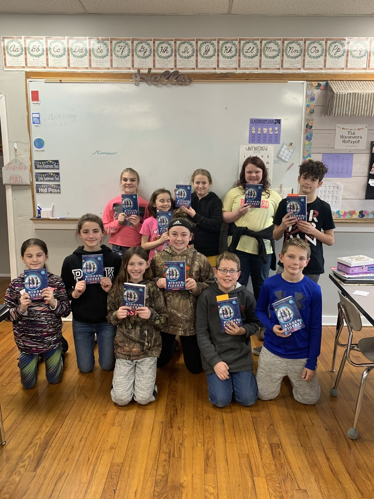 Fifth Grade with their books